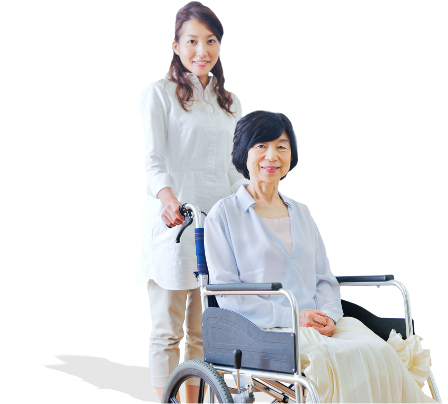 caregiver and an elderly woman on a wheelchair smiling for the camera
