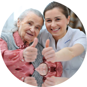 caregiver and an elderly woman posing for the camera