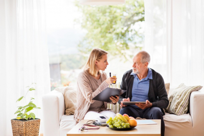caregiver the elderly talking while eating
