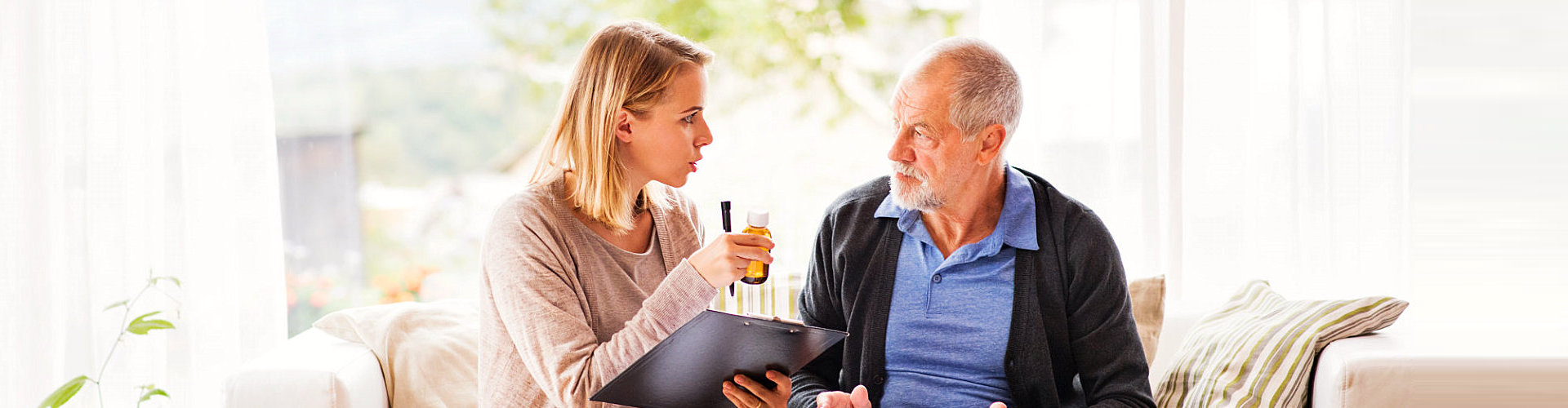 caregiver and elderly talking while eating