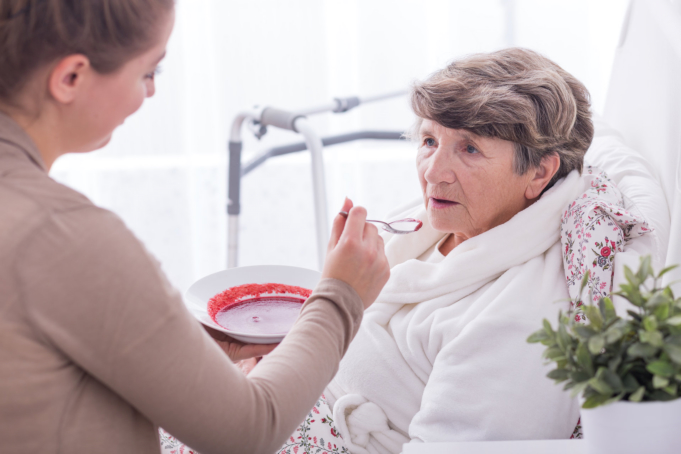 the caregiver taking care of the elderly